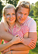 Stock Photo : Smiling Pictures: Young Blonde Couple Outdoors