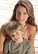 Young Woman & Boy Sitting On The Dock - stock photography