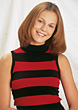 Stock Photo : Smiling Stock Photo: Young Woman In Red &amp; Black Sweater